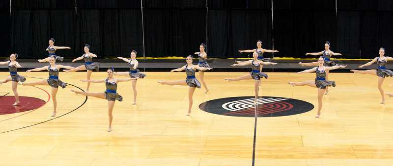by: SUBMITTED PHOTO: JAMES MCGREW - Lake Oswego High team dazzled in the 6A intermediate category with lifts, leaps and several a la seconde turns.