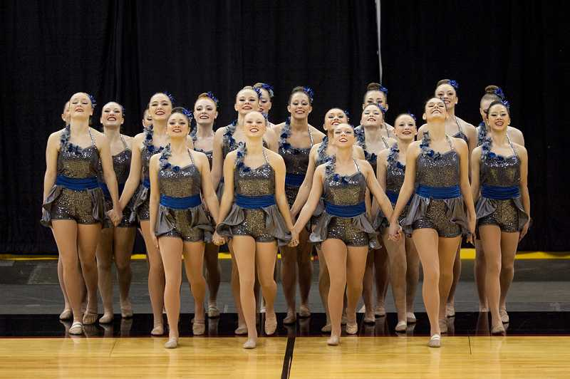 by: SUBMITTED PHOTO: JAMES MCGREW - The Lakers hold hands as they step onto the floor for their performance at the state championships last week.
