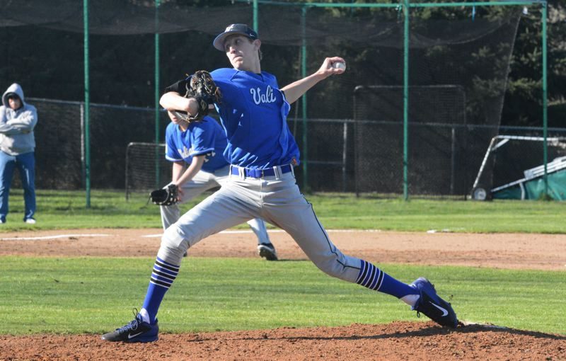 by: TIMES PHOTO: MATT SINGLEDECKER - Valley Catholic senior pitcher Carter Buuck struck out 14 batters in his season debut 10-0 win over Dayton on Thursday.