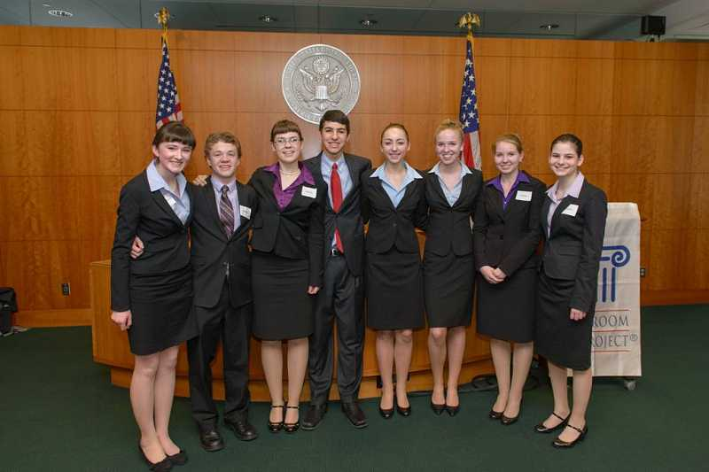 by: SUBMITTED PHOTO: ANDIE PETRUS PHOTOGRAPHY  - West Linn High Schools mock trial Green team took first place in the recent state competition and will head to nationals next month. From left, team members Claire Baumgardner, Lucas Evans, Kira Duff, Kevin Layoun, Elizabeth Torralba, Emily Rissberger, Rachel Dawson and Rochelle Biancardi.