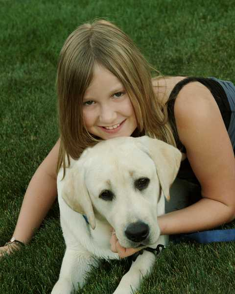 by: SUBMITTED PHOTO - Anika Bjornson is shown with her service dog, Bassi.