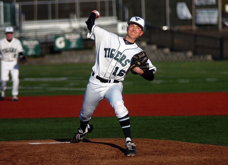by: DAN BROOD - THE DELIVERY -- Tigard junior Henry Amman gets ready to deliver a pitch in Saturday's game against Central Catholic.