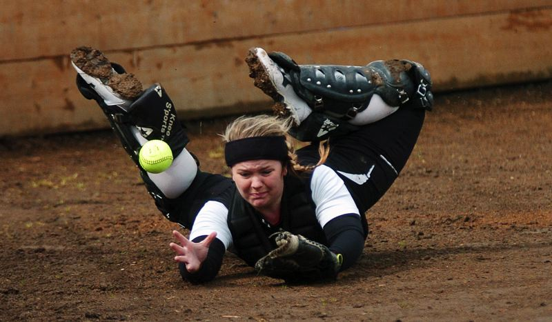 by: DAN BROOD - GOING ALL OUT -- Sherwood senior catcher Margaret Gaither gives it everything she has as she attempts to catch a foul ball in Tuesday's game.