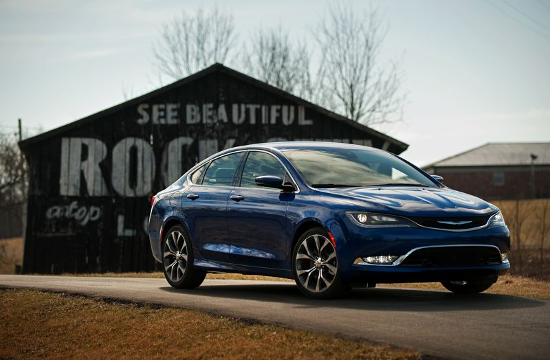 by: JOHN M. VINCENT - The front of the 2015 Chrysler 200 is the new face of Chrysler. Fluid lines grace the coupe-like profile.