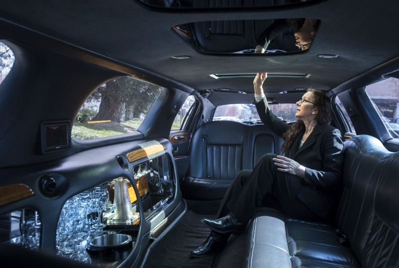 by: TRIBUNE PHOTO: JONATHAN HOUSE - Lucky Limousine and Towncar Service chauffeur Sally Donahue checks the cabin of one of the fleets limousines in between calls.