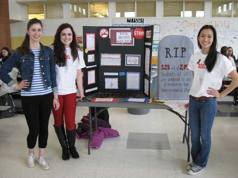 by: SUBMITTED PHOTO - Megan Fleming, Katherin Tillett and Jesica Vo represented the Rebels at Sunset High School. They used the tombstone prop to share the statistic that 13 percent of people 17 and younger will die from tobacco use each year.