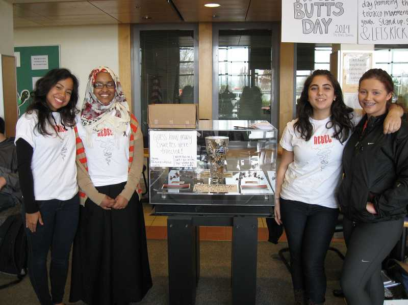 by: SUBMITTED PHOTO - Beaverton High School students, from left, Jessica Maung, Amelia Monfared, Marwa Al-Khamees and Makenna Roggen represent the Rebels, an anti-tobacco group of local high school students on National Kick Butts Day on March 19.