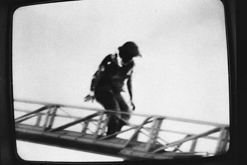 by: PAMPLIN MEDIA GROUP FILE PHOTO: VERN UYETAKE  - On fire, Terry Bowman descends an aerial ladder in this video grab taken by a local television cameraman on March 19, 1979. He suffered the worse survivable burns ever received by a Tualatin Valley Fire & Rescue firefighter in the area that anyone can remember.