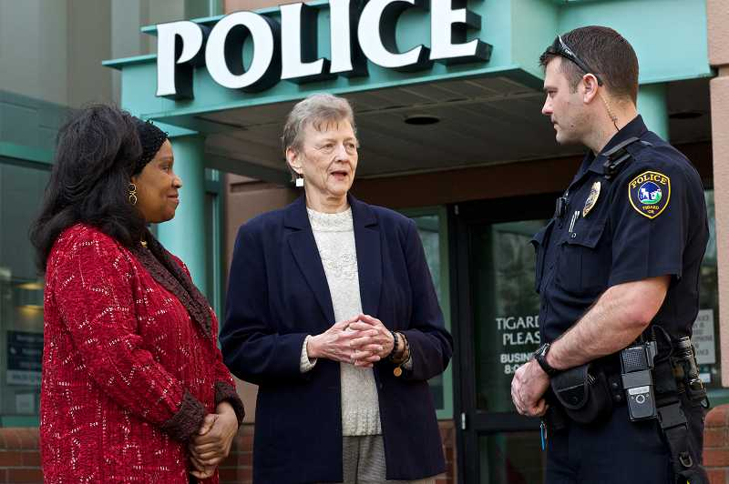 by: TIMES PHOTO: JAIME VALDEZ - Victims Phyllis, left, and Bonnie Owens talk with Tigard Police Officer Gabe Stone about their experiences. Neither woman sent money to callers, but police have recorded more than $10,000 in fraudulent transfers since January.