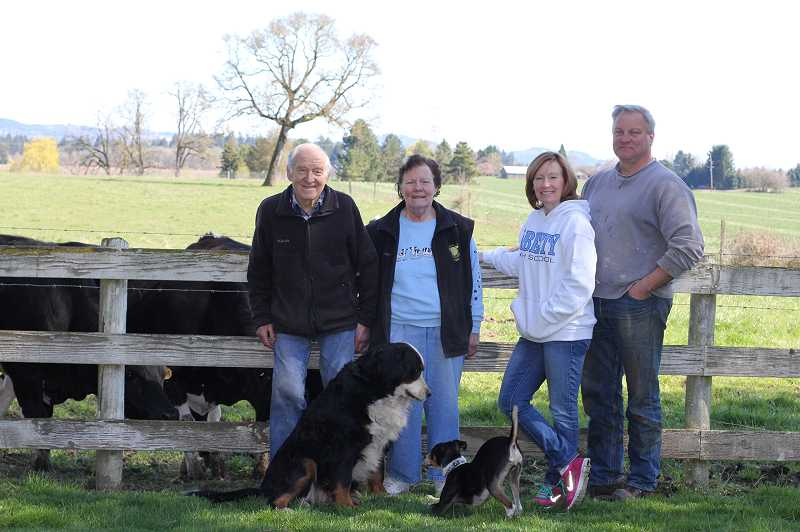 by: NEWS-TIMES PHOTO: STEPHANIE HAUGEN - (Left to right) Hans, Sally, Casey and Dave stand in front of grazing cows on the place they all call home -- the Schoch Dairy.