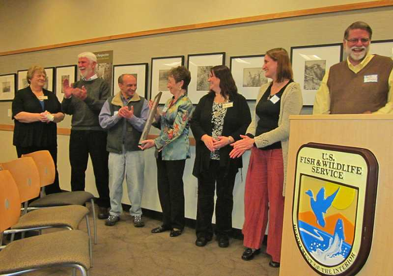 by: BARBARA SHERMAN - CELEBRATING A WELL-DESERVED AWARD - Just after being presented with the 2014 Friends Group of the Year Award, President Cheryl Turoczy Hart (fourth from left) shows it to the other members of the Friends of the Tualatin River National Wildlife Refuge Board of Directors: (from left) Sharon Miller, Gary Fawver, Louie Olivares, Bonnie Anderson, Michelle Miller and Berk Moss.
