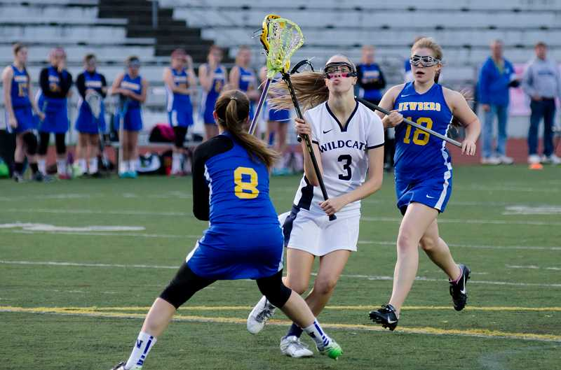 by: GREG ARTMAN - First team all-state midfielder Abby Chase (3) returns for her final season with the Wilsonville girls lacrosse team, which went 19-2 last year.