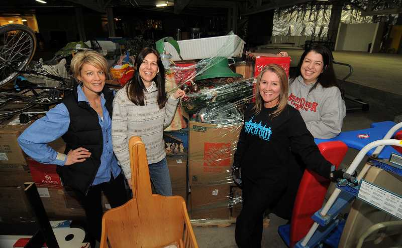 by: PAMPLIN MEDIA GROUP: VERN UYETAKE - Working on a garage sale fundraiser not only raises money but also creates a strong sense of community. From left, Erin Finklea, Erica Yraguen, Michele Jaffe and Saleen Chenevert are four members of a group that has been working for the past four months on Athey Creek Middle School's third annual PTSA garage sale. Jaffe works with a similar group of enthusiastic volunteers at WHS.
