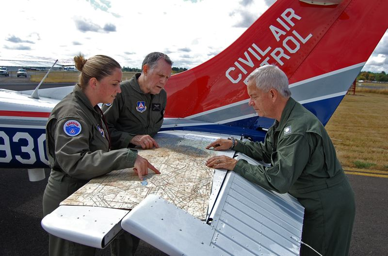 by: SUBMITTED PHOTO - Oregon Civil Air Patrol members are shown at the Aurora State Airport during a recent statewide CAP exercise.