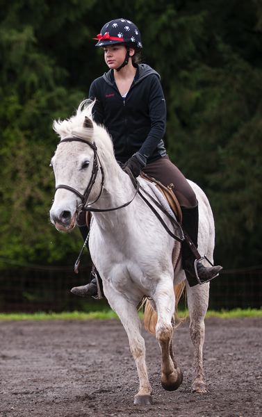 by: SPOKESMAN PHOTO: JOSH KULLA - Audrey Minch is shown here riding at Big Dog Stables outside Oregon City. She and her twin sister Abigail also work with the Once Upon a Rescue sanctuary for horses taken from high-risk situations.