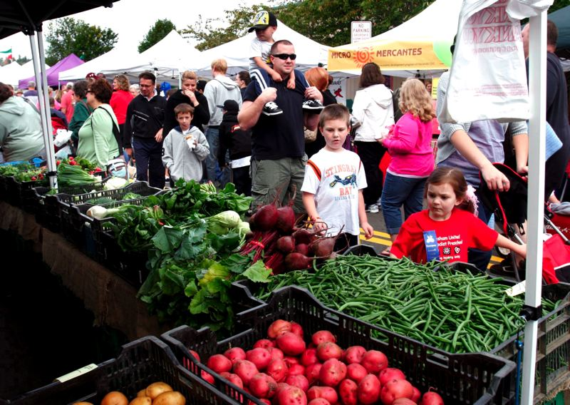 by: OUTLOOK FILE PHOTO - The Gresham Farmers Market was established in 1986, following a nationwide trend by consumers for farm-to-table consumable goods. The market has been located on Northwest Third Street, between Miller and Main avenues, since 1999.
