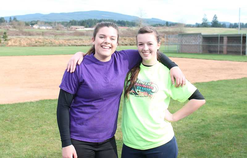 by: CORY MIMMS - Pitcher Becky Patterson and catcher Cassondra Neff before practice. Coach Jim Brochis was happy with how they performed last week in Union.
