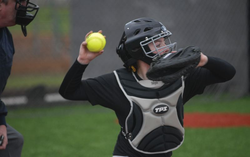 by: ESTACADA NEWS: DAVID BALL - Estacada catcher Hailey Clark fires the ball back to the pitcher.