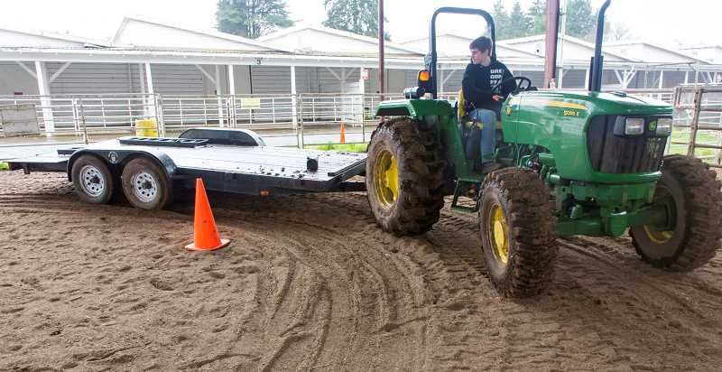 by: RAY HUGHEY - Canby's Logan Wood works through the cone course during testing.