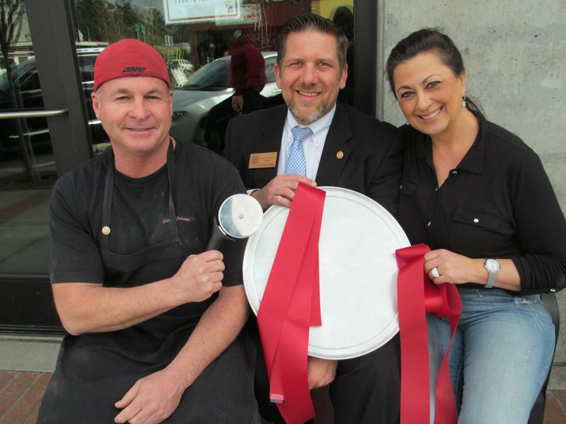 by: PHOTO BY ELLEN SPITALERI - Woodpecker Pizza owner Lindsey Morstad, left, wields the pizza cutter, while Milwaukie Mayor Jeremy Ferguson and Cindy Kauffman hold the ceremonial red ribbon.