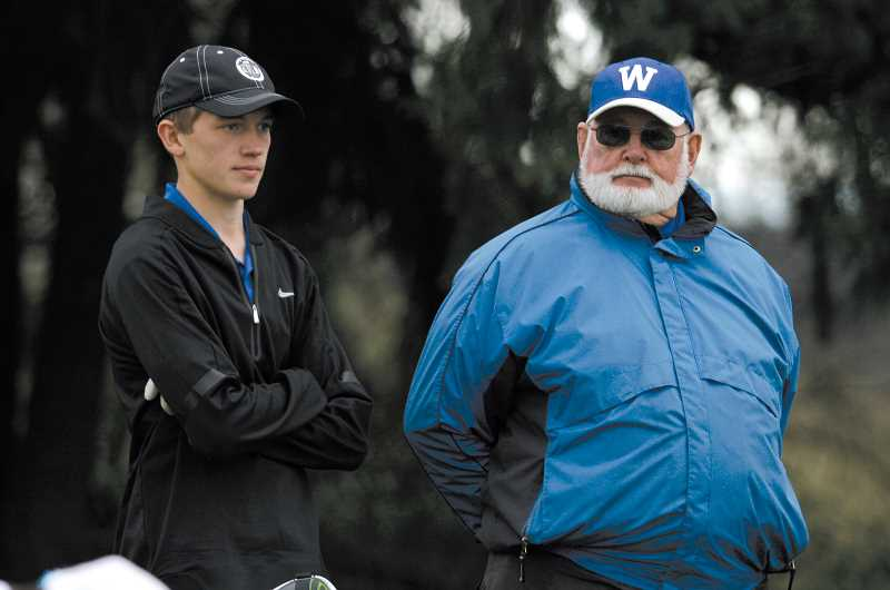 by: PHIL HAWKINS - Woodburn juniors Julian Kuznetsov (standing above with coach Bill Mickle,) and A.J. Martinez, are helping to put the Bulldog golf team on the map, as the team aims to qualify for the state tournament this May, said boys coach Bill Mickle (above right).