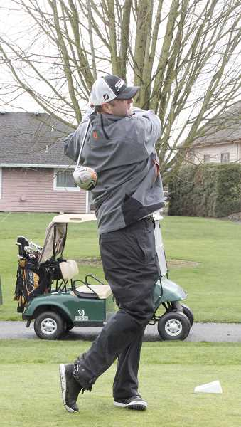 by: LINDSAY KEEFER - Dan Baggett of Tualatin takes a practice swing at  the Woodburn golf teams fundraiser tournament at OGA Course at Tukwila on Thursday. Proceeds from the event went to help the boys and girls golf teams pay for additional matches and gear.