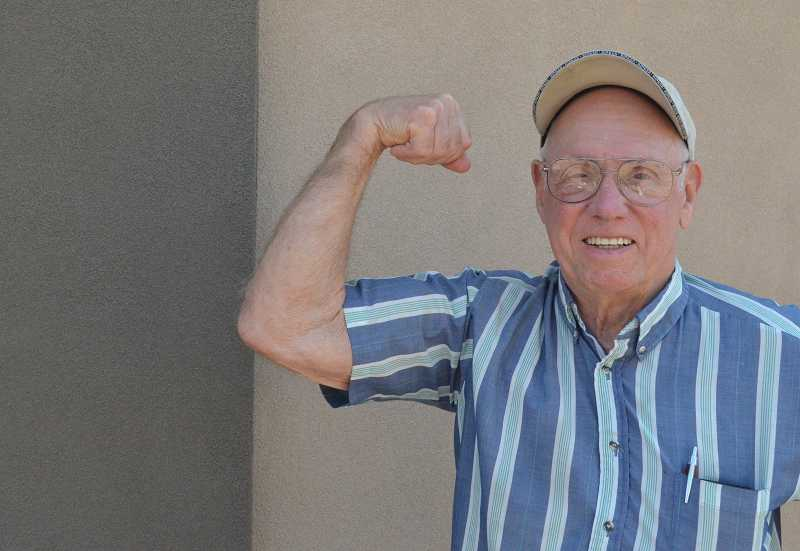 by: JEFF GOODMAN / FILE - Canby resident Roger Moore, 85, set a world bench-press record for his age group and weight class March 15 in Portland during a sanctioned weightlifting competition.
