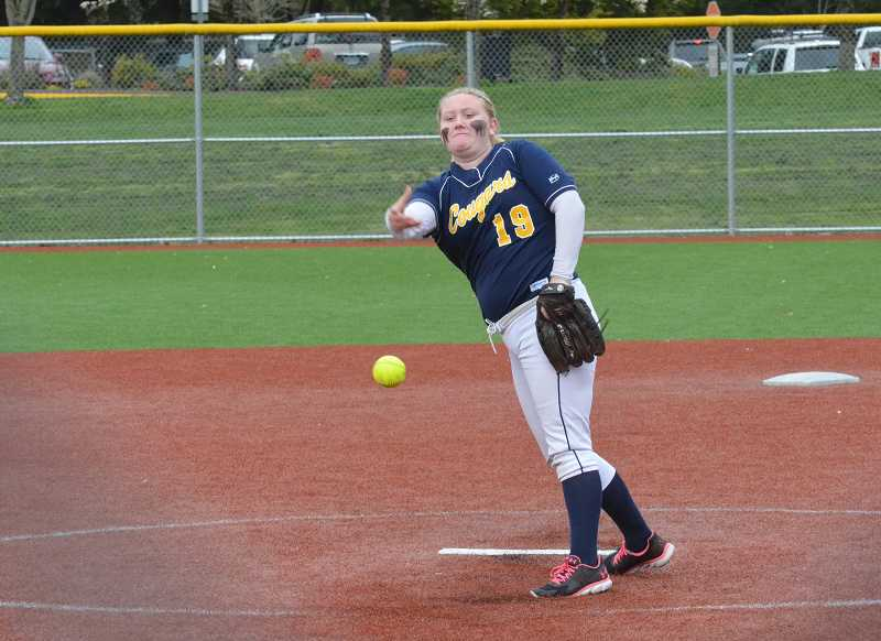by: JEFF GOODMAN / PAMPLIN MEDIA GROUP - Aunika Turner unleashes a pitch March 19 during the Canby softball team's nonconference game at Wilsonville. Turner threw a complete game and also went 4-of-5 at the plate to lead the Cougars in a 6-1 victory.