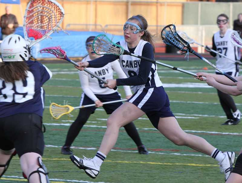 by: ALLAN O'CONNOR - Alexa Nakashimada, shown during her playing days at Canby, is leading the George Fox women's lacrosse team in its inaugural season.