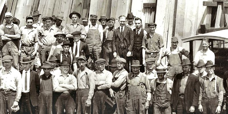 by: SMILE HISTORY COMMITTEE COLLECTION - This 1926 photo taken at the Eastside Lumber Mill shows the unique character and the different styles of hats chosen by the men of millwork.