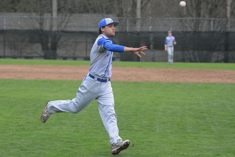 by: TIMES PHOTO: MATT SINGLEDECKER - Aloha senior Richard Belog has pop in his bat and can throw heat from the mound for the Warrior baseball team thats looking to rise up the Metro ranks.