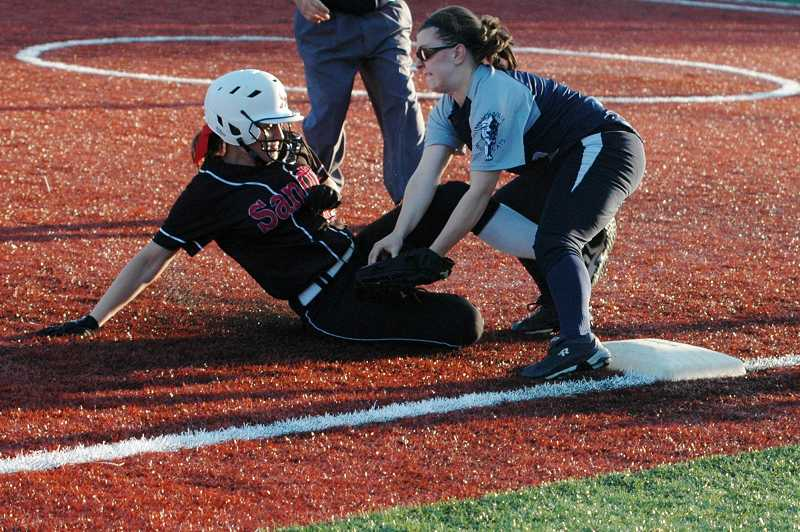 by: PARKER LEE / FILE - Third baseman Hannah Lopez (right), shown during a game at Sandy last year, will play a key role in the Wilsonville softball team's first season under coach Mick Johnson.
