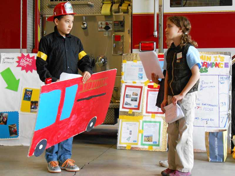by: SUBMITTED PHOTO - Alex Malmros and app-expert Tessa DiVergilio perform their skit for Destination Imagination before Lake Oswego fire officials in March.
