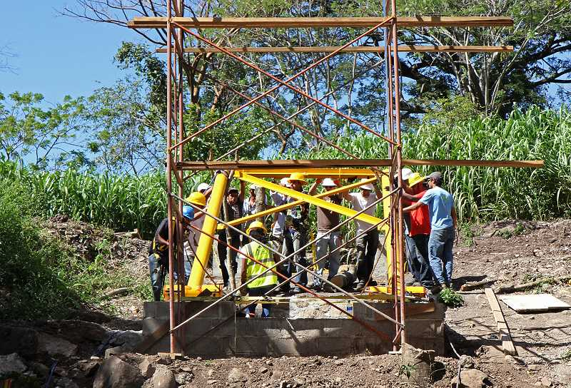 by: SUBMITTED PHOTOS - Ralph Salamie and his fellow engineers proved they did not need high tech tools to build a bridge when they went to the jungles of Nicaragua.
