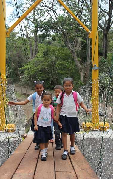 A group of school children was passing by when the youngsters were invited to be the first people to cross the new bridge of Esquipulas in Nicaragua.