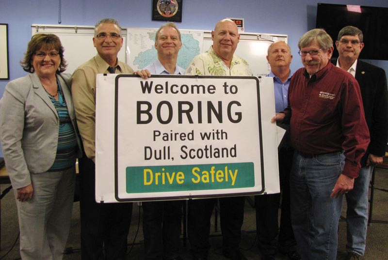 by: CONTRIBUTED: CLACKAMAS COUNTY - Holding a mock-up of a sign touting Borings relationship with Dull, Scotland, placed last year in Boring Station Trailhead Park, are, from left, Clackamas County Commissioner Tootie Smith; Rep. Bill Kennemer, R-Oregon City; commissioners Paul Savas, John Ludlow and Jim Bernard; Boring Community Planning Organization Chairman Steve Bates; and Sen. Alan Olsen, R-Canby. The small sign soon will be replaced with a much larger one on Highway 212 between the communitys two stop lights.