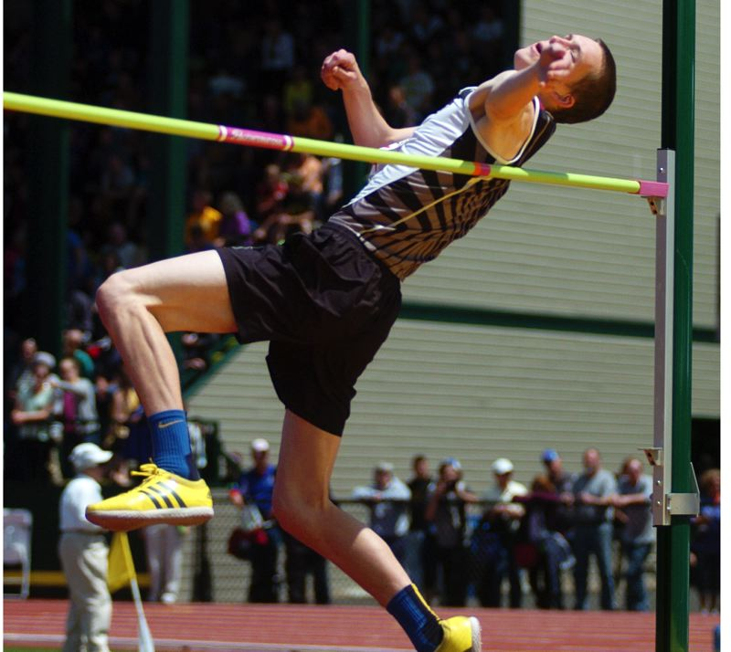 by: DAN BROOD - HIGH FLYER -- Sherwood junior Ben Milligan, shown here at last year's Class 5A state meet, is one of the key returnees for the Bowmen this season.