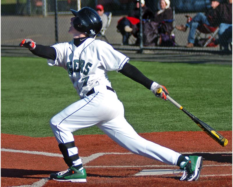 by: DAN BROOD - GETTING HIS CUT -- Tigard senior Bruin Campbell takes a swing during an early-season game for the Tigers.