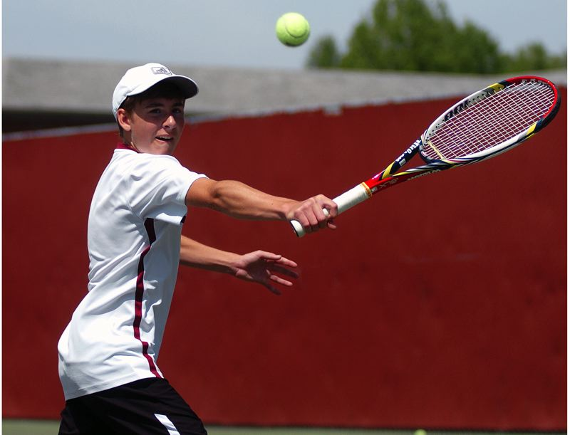 by: DAN BROOD - SINGLES STAR -- Sophomore Ryan Malinowski, shown here at last year's district tournament, will play at No. 1 singles for the Wolves.