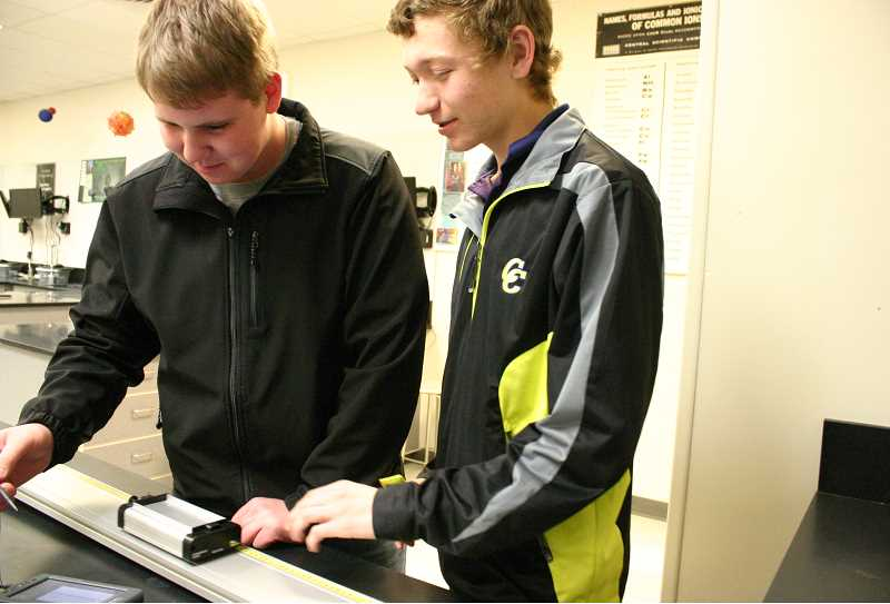 by: JASON CHANEY - Crook County High School students Brick Woodward (LEFT) and Kody Kuk work with some physics equipment purchased with money from a 2013 Facebook Community Action grant. The high school science department received another $8,000 grant this year.