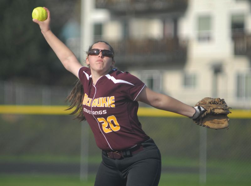 by: PAMPLIN MEDIA GROUP: DAVID BALL - Milwaukie pitcher Lydia Daschel-Lloyd winds up and delivers during the teams home win over Centennial last week. She retired the side in order to start the game.