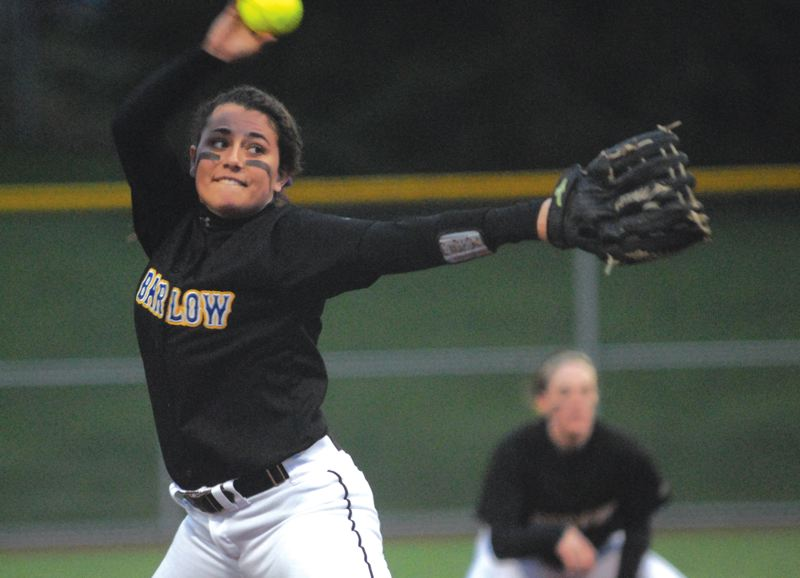 by: THE OUTLOOK: DAVID BALL - Barlow pitcher Abbie Bergerson winds up and delivers during Tuesday nights 8-6 win at West Linn.