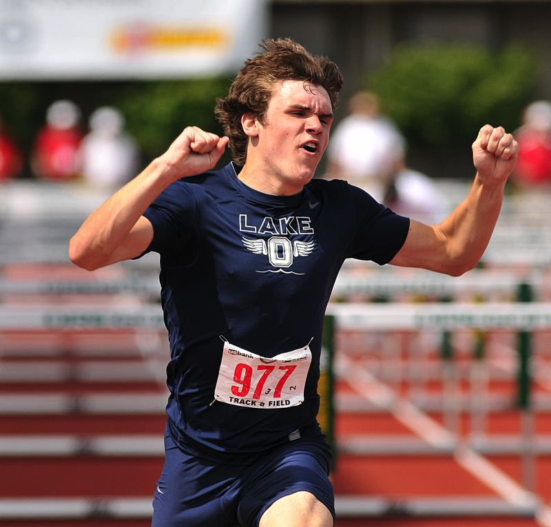 by: VERN UYETAKE - Lake Oswego's Connor Bracken won the state championship in the intermediate hurdles last year and returns to the Lakers this spring to defend his title.