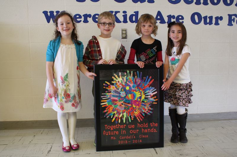 Grant Watts Elementary School first-grade students hold a circle of hand-crafted hands. The students' artwork will be auctioned off at the event, as well as many other items. Left to Right: Ava Vetsch, Evan Barham, Brooke Johnston and Addison Schrotzberger.
