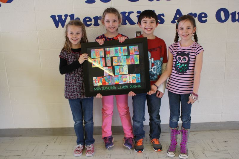 Grant Watts Elementary School second-grade students hold a water color quote. The students' artwork will be auctioned off at the event, as well as many other items. Left to right: Makenna Fraser, Maddie Prockish, Dominic Squires and Peyton Lennox.