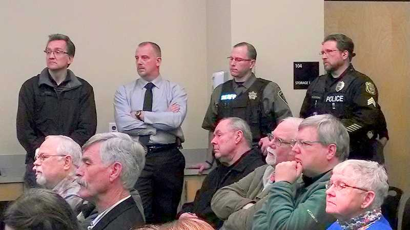 by: OUTLOOK PHOTO: CARI HACHMANN - Sheriffs deputies, Troutdale officers and citizens fill the police community room to hear the sheriffs proposal to contract police services with the city of Troutdale.