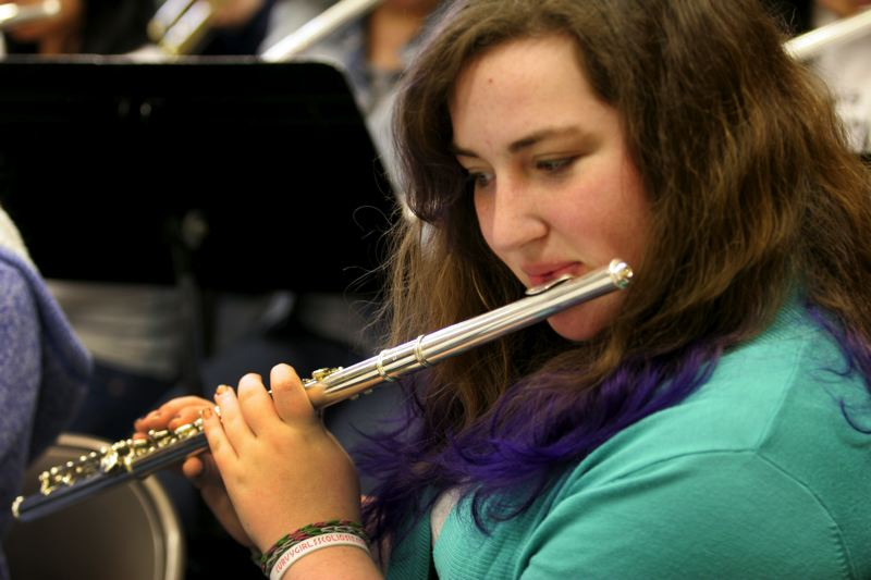 by: OUTLOOK PHOTO: JIM CLARK - An eighth-grader at Centennial Middle School, Rebecca plays flute in the schools band and is an active member of her Girl Scout troop. She hopes to own a bakery one day, after learning how to decorate cakes from her grandmother and mom.