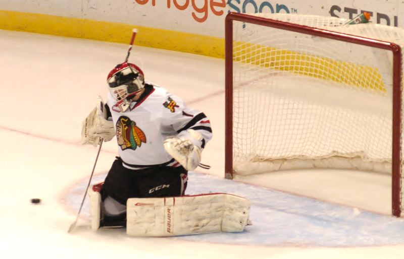 by: PAMPLIN MEDIA GROUP: PARKER LEE - Winterhawks goalie Brendan Burke turned away 25 shots during the teams 8-2 win over Victoria to open the Western Conference semifinals Friday night.