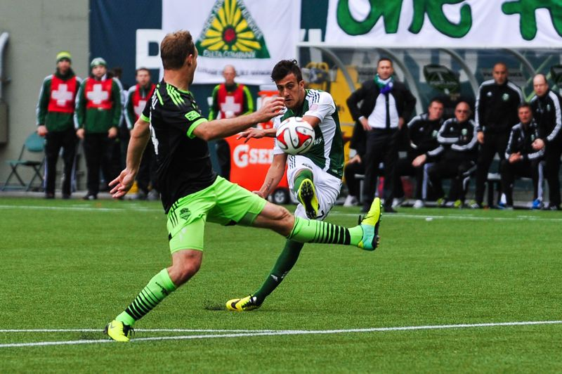 by: COURTESY OF JOHN LARIVIERE - Maximiliano Urruti of the Timbers scores versus the Sounders.