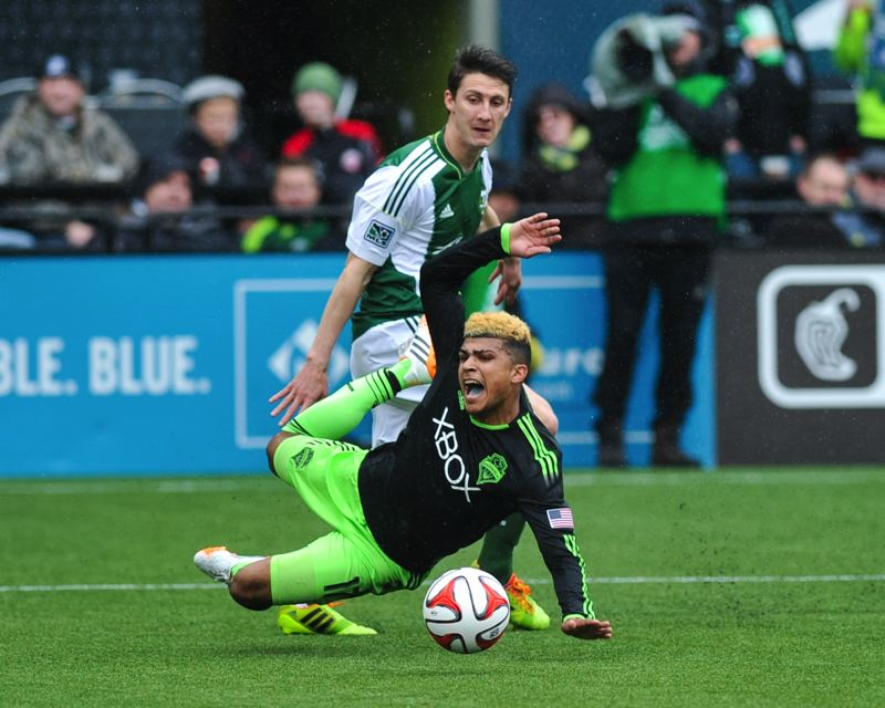 by: COURTESY OF JOHN LARIVIERE - Seattle's DeAndre Yedlin hits the turf after a foul by Portland's Ben Zemanski. The play gave the Sounders a penalty kick, which Clint Dempsey converted in the 87th minute to pull Seattle even with Portland in their 4-4 draw Saturday at Providence Park.